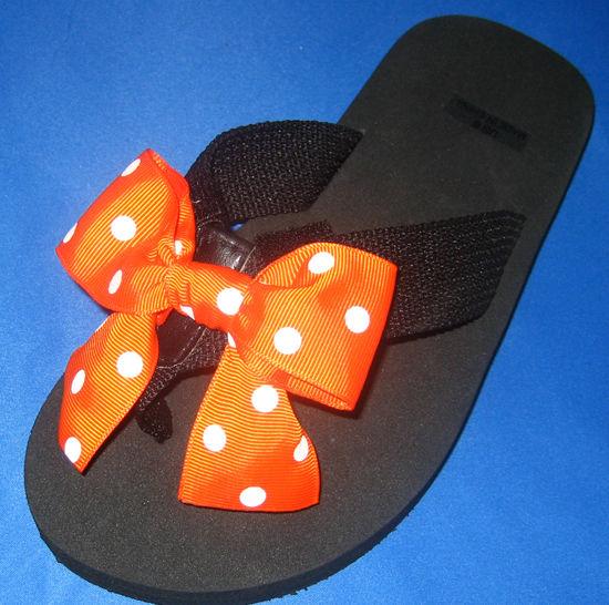 Orange with White Polka dots child's flip flop.