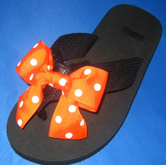 Orange with White Polka dots child's flip flop.