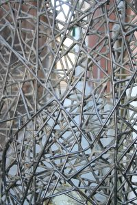 unique designed trellis from Italy. Very interesting. I don't know if one can grow vines on it. But later their are unique trellis that are for home decor.