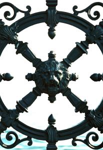 Regal Iron trellis. Regal. Old world. To enhance a view of the rest of the yard.